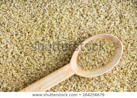 Cracked wheat background texture with angled spoon Stock photo © ozgur