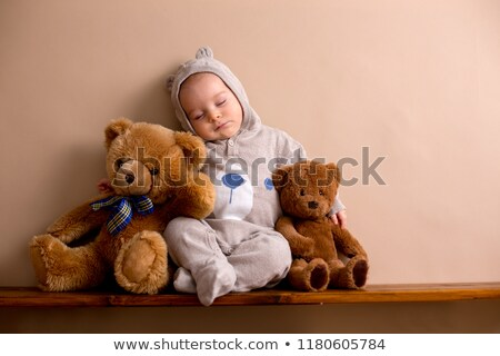 Portrait of a Boy with Fluffy Hat and Stuffed Animal  Stock photo © courtyardpix