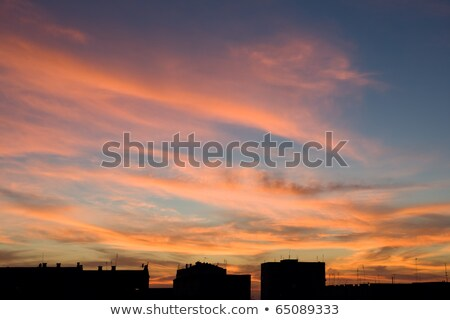 A beautiful cloudy sky at sunset pierced rays. Stock photo © All32