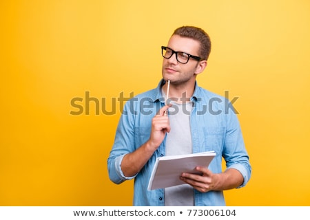 Guapo joven pensando mano barbilla blanco Foto stock © wavebreak_media