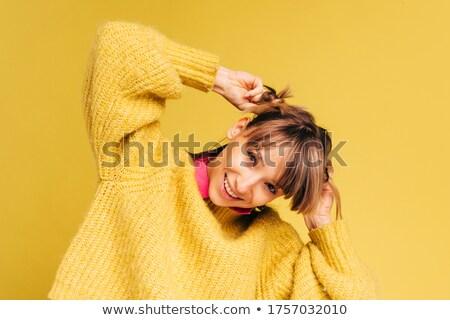 Mosolyog aranyos fitnessz nő tart haj lófarok Stock fotó © deandrobot
