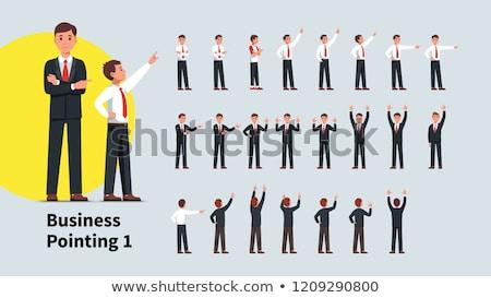 Business man or employee pointing upward. Stock photo © RAStudio