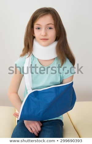 Girl Wearing Neck Brace And Arm Sling Stock photo © AndreyPopov