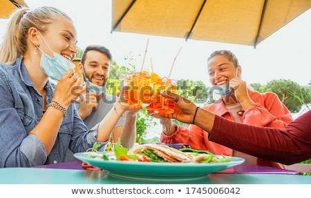grupo · amigos · Pareja · fiesta · restaurante · hombre - foto stock © deandrobot
