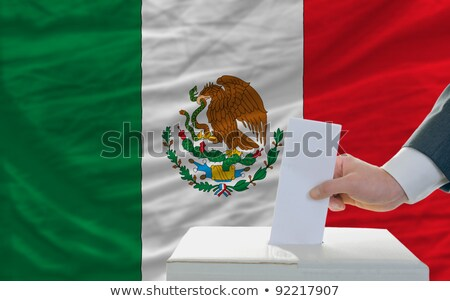 Man putting a ballot into a voting box - Mexico Stock photo © Zerbor