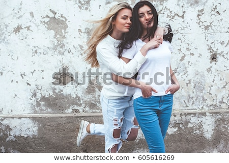 two brunette girls in casual clothes posing stock photo © dash