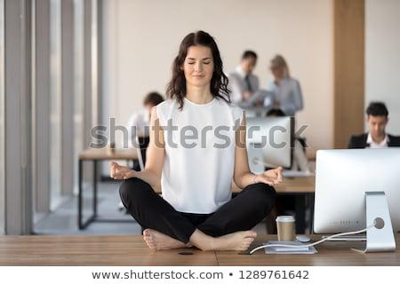 Photo stock: Business Woman Doing Yoga Meditation On Office Desk