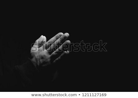 Man praying in the dark Stock photo © zurijeta