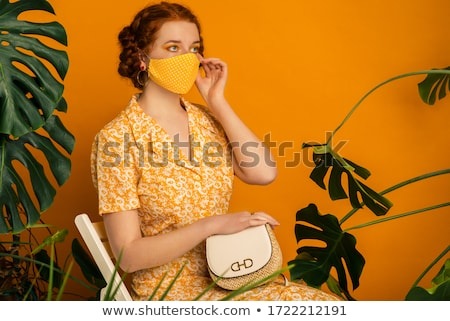 Attractive woman with freckles holding bags Stock photo © Aikon