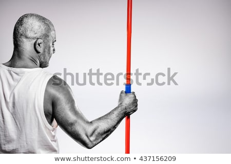 Foto stock: Composite Image Of Rear View Of Athlete Standing With Javelin