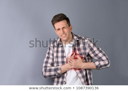 Man having heart attack Stock photo © bluering