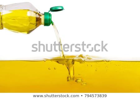 Stock photo: Oil pouring from a bottle.