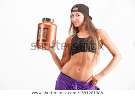 Happy girl with protein jar. Stock photo © Kurhan