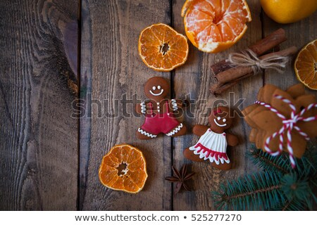 Christmas composition. Xmas cookies, Gingerbread man, tangerines Stock photo © Yatsenko