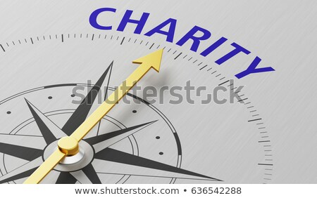 Compass needle pointing to the word Charity Stock photo © Zerbor