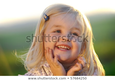 Relaxed young blond girl posing in the park. Stock photo © lithian