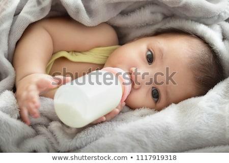 mom is feeding the baby milk from a bottle Stock photo © dmitriisimakov
