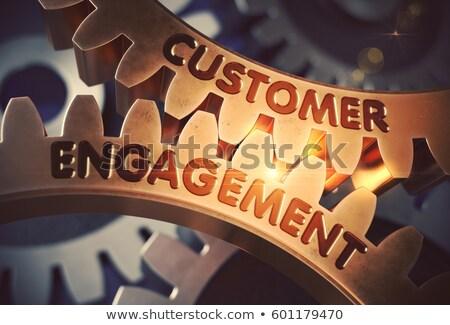 Customer Engagement on Golden Cog Gears. 3D Illustration. Stock photo © tashatuvango