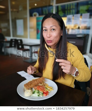 young woman with Norwegian fish Stock photo © svetography