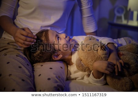 Girl resting head in mother' lap Stock photo © IS2