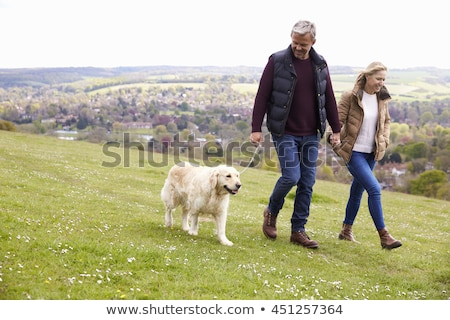 Mature couple walking together Stock photo © IS2