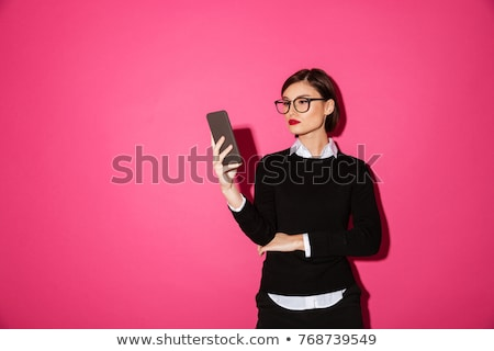 Young confident lady in black pullover using smartphone isolated Stock photo © deandrobot