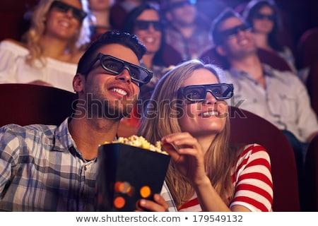 женщину 3d очки смотрят фильма улыбаясь еды Сток-фото © studiostoks