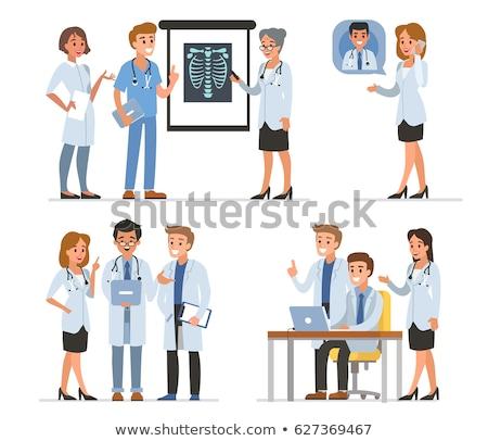Orvos bemutat okostelefon nő kommunikáció női Stock fotó © FreeProd