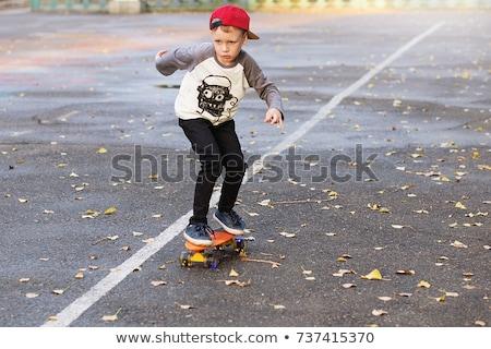 Kid Boy School Ride Skateboard Stock photo © lenm