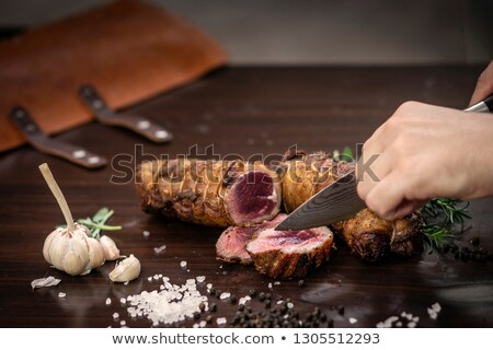 slicing organic roast beef roll on wood table with ingredients Stock photo © travelphotography