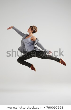 bastante · loiro · dançarina · saltar · mover - foto stock © majdansky