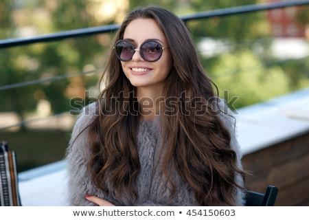 задумчивый осень пальто Hat сидят Сток-фото © deandrobot