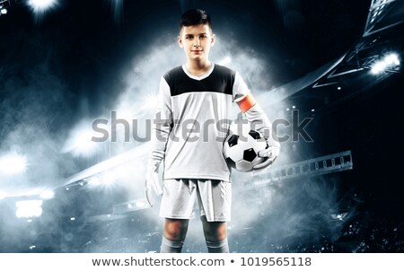 soccer goalkeeper on the field football training game for kids young boy as a football goalkeeper stock photo © matimix