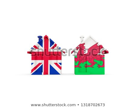 Two houses with flags of United Kingdom and wales Stock photo © MikhailMishchenko