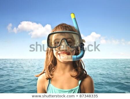 Child wearing snorkeling mask diving underwater Stock photo © galitskaya