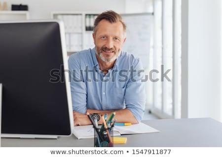 Thoughtful businessman staring at desktop monitor Stock photo © Giulio_Fornasar