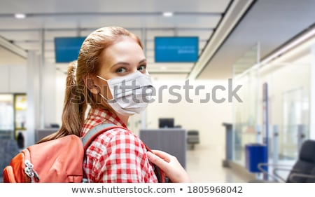 young woman with backpack over airport terminal Stock photo © dolgachov