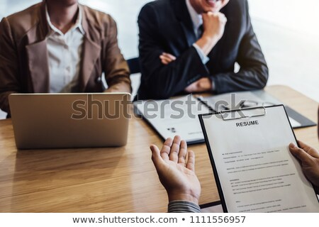 Business man holding his resume during job interview to Executiv Stock photo © Freedomz