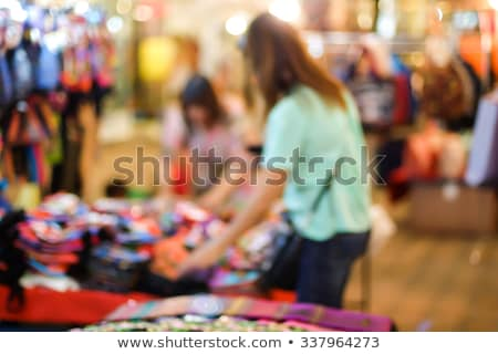 people at souvenirs shop buying products items stock photo © robuart