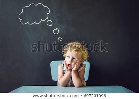 портрет Cute девочку мышления что-то Сток-фото © galitskaya
