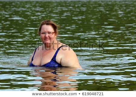 plump woman bath in river Stock photo © Mikko