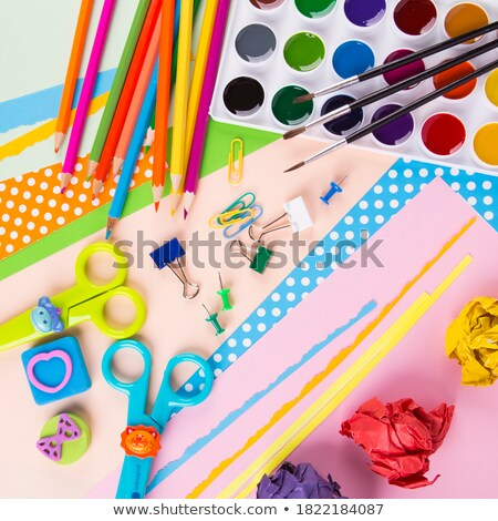 Color pencils near note on wooden background. Top view. Copy space. Stock photo © Illia