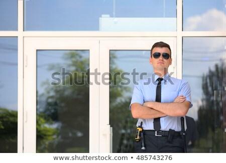 Guardia de seguridad puerta entrada jóvenes pie vidrio Foto stock © AndreyPopov
