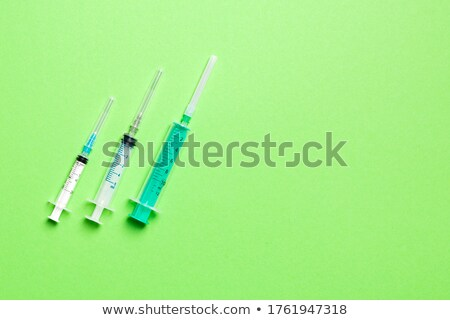 Therapeutic pattern of plastic syrenges with colorful vaccines. Stock photo © artjazz