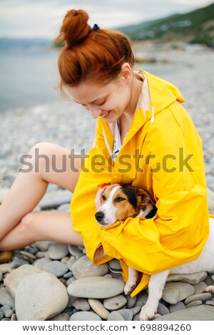 Woman with raincoat on the side of the beach Stock photo © Lopolo