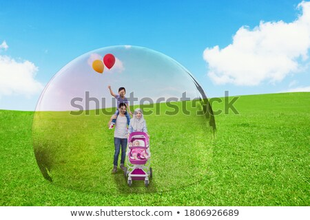 parents and son daughter baby pram in the park family protection Stock photo © yupiramos