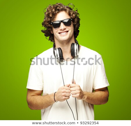 Young man with sunglasses and headphones stock photo © Paha_L