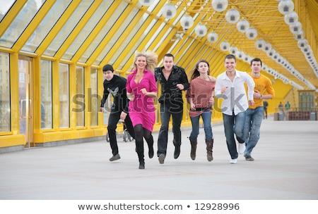 Grupo jóvenes amigos amarillo puente peatonal sonrisa Foto stock © Paha_L