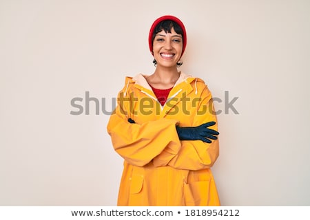 Belo mulher jovem capa de chuva retrato sorridente morena Foto stock © elenaphoto