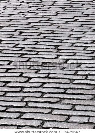 Close up of cobbles in an old English cobblestone street in Truro, Cornwall UK. Stock photo © latent